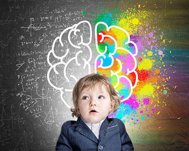 Little boy and a colorful brain sketch - foto de stock