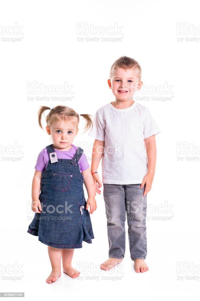 Little Boy and girl full-lenght portrait stock photo