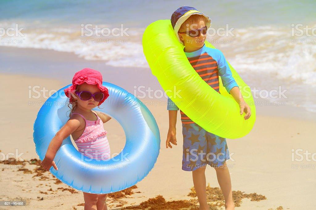 little boy and girl go swim on beach Lizenzfreies stock-foto
