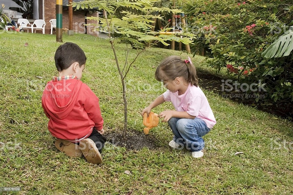 Little boy and girl having gardening time royalty-free stock photo