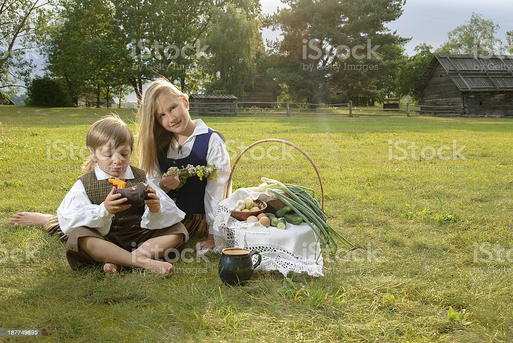 Little boy and girl in a national latvian clot stock photo