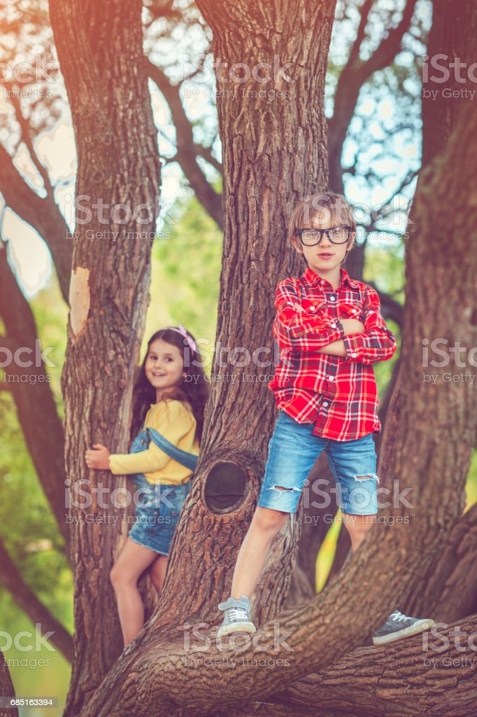 Little boy and girl in park in summer royalty-free stock photo