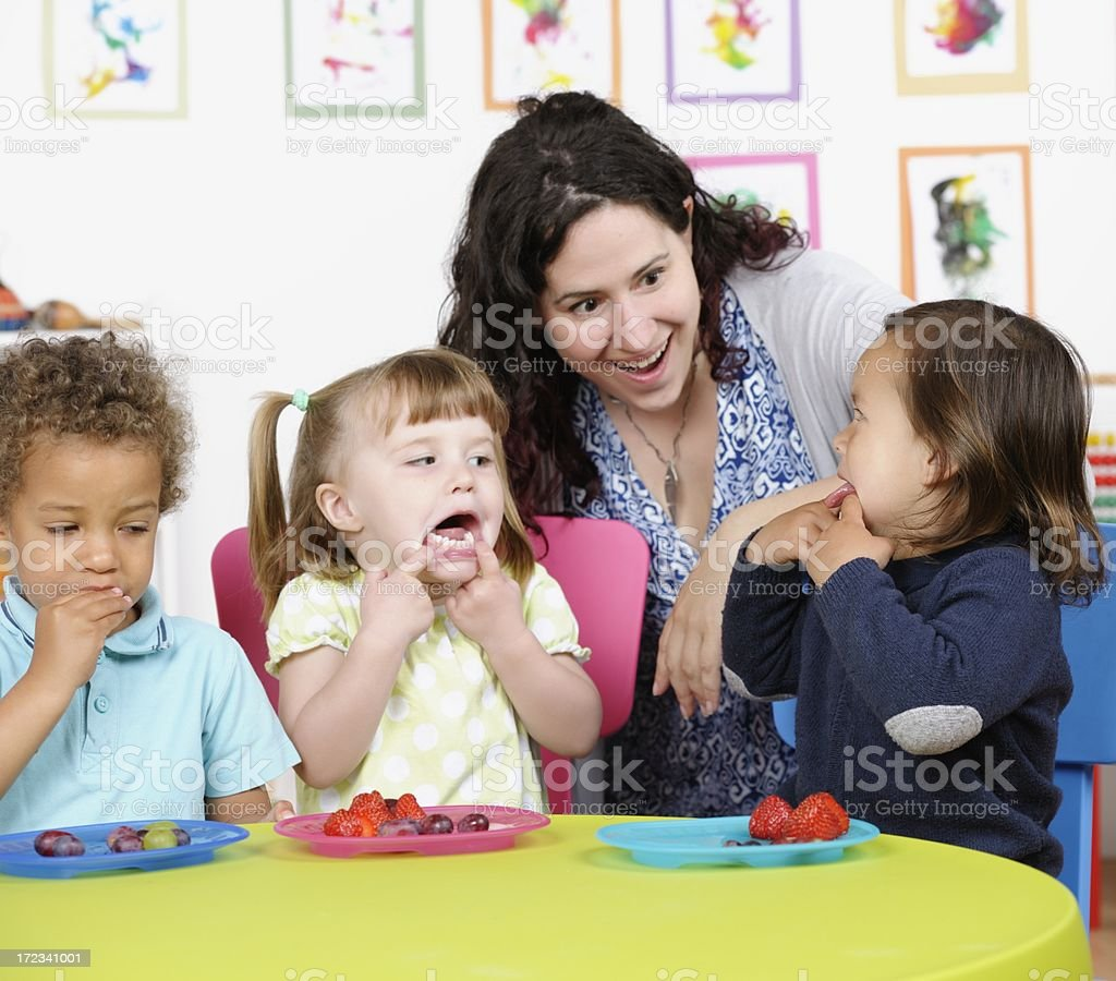 Little Boy And Girl Messing About At Mealtime stock photo