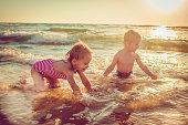 Happy children running by the sea