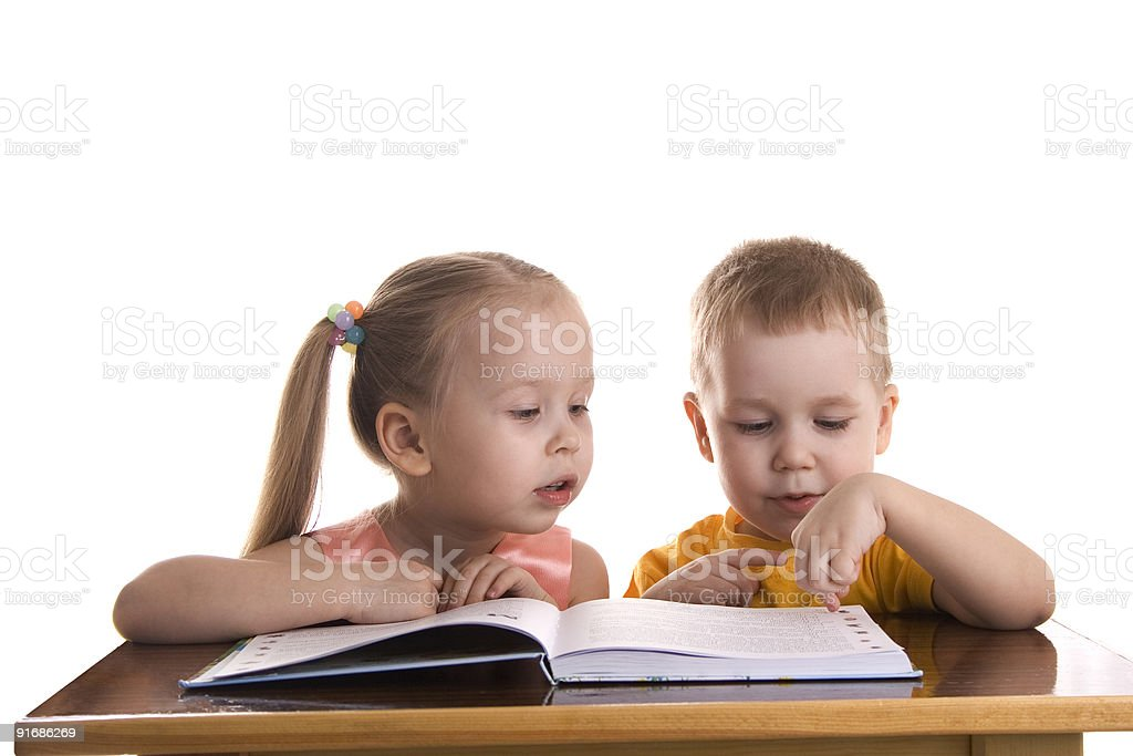 Little boy and girl reads the book royalty-free stock photo