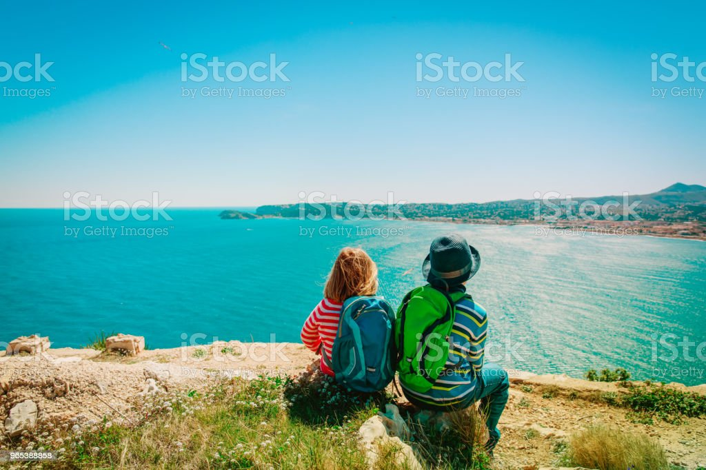 little boy and girl travel in nature royalty-free stock photo
