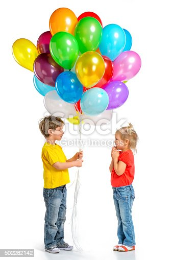 istock Little boy and girl with balloons 502282142