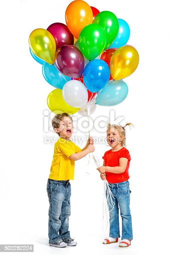 istock Little boy and girl with balloons 502282224