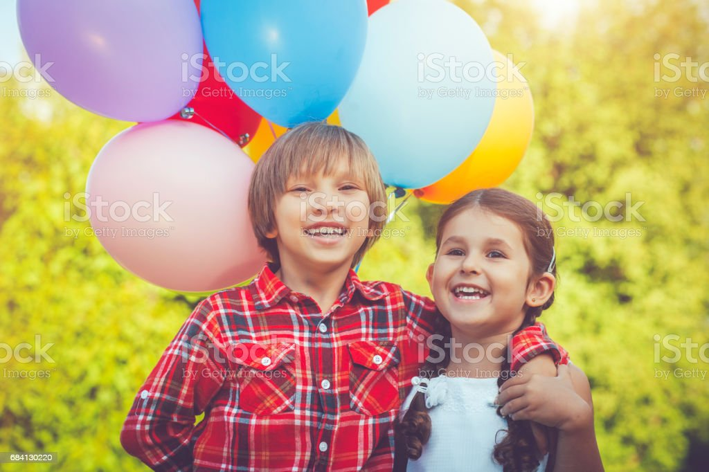 Little boy and girl with balloons zbiór zdjęć royalty-free