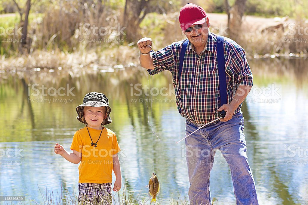 Little Boy and His Grandpa Fishing stock photo