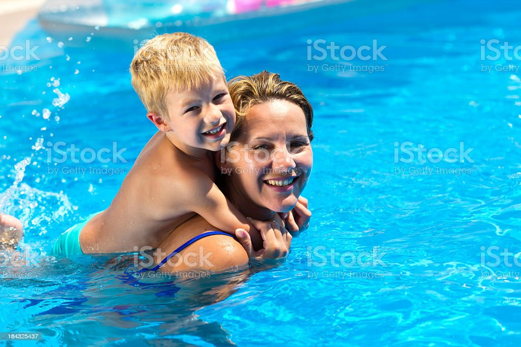 Little Boy And His MotherSwimming In The Pool royalty-free stock photo