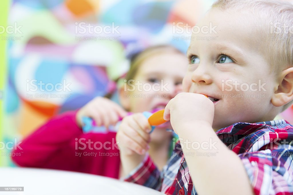 Little boy and his sister brushing teeth royalty-free stock photo