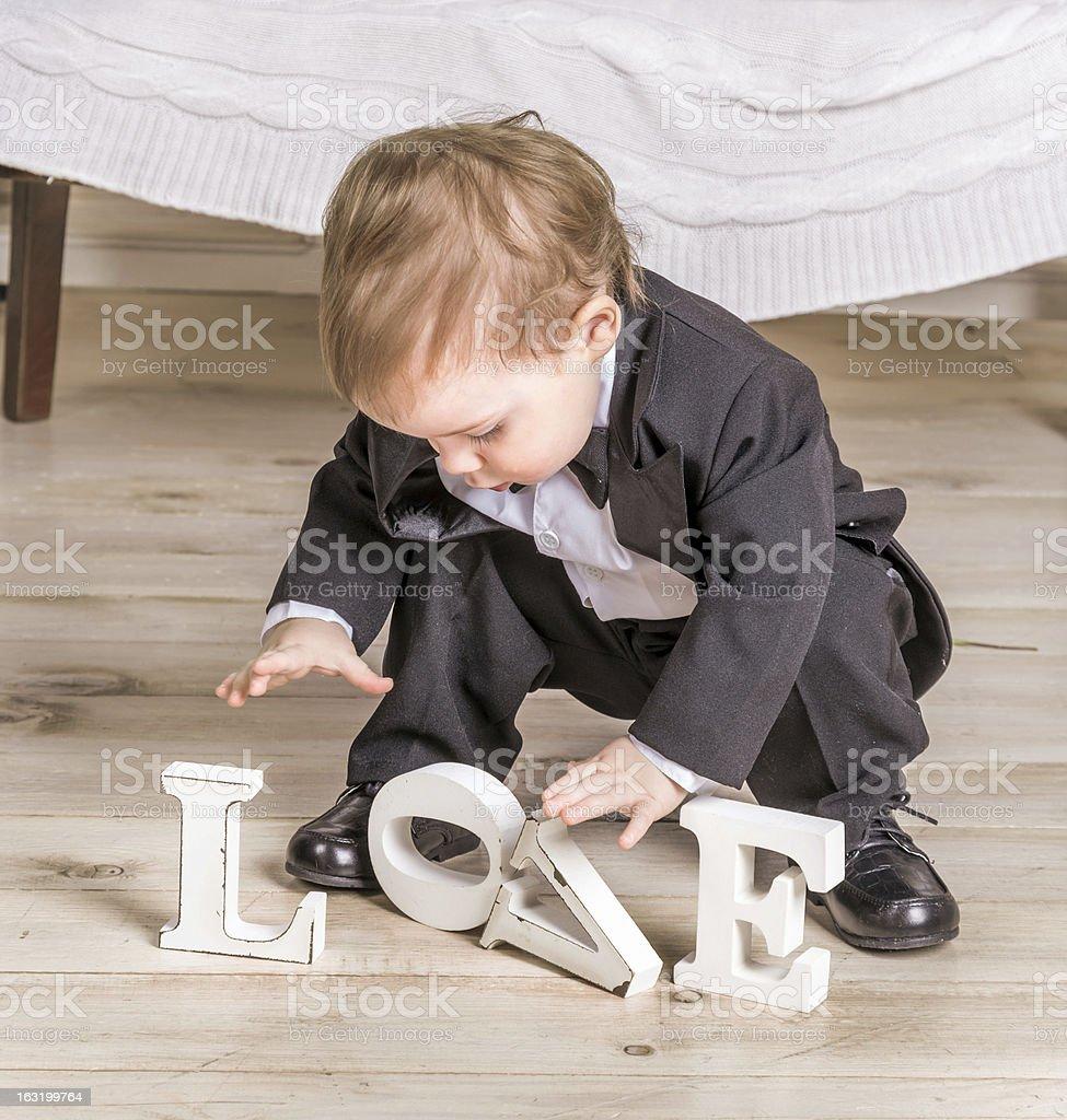 Little boy and inscription LOVE stock photo