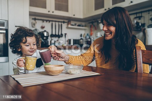 istock Little boy and mom on the table 1130362519
