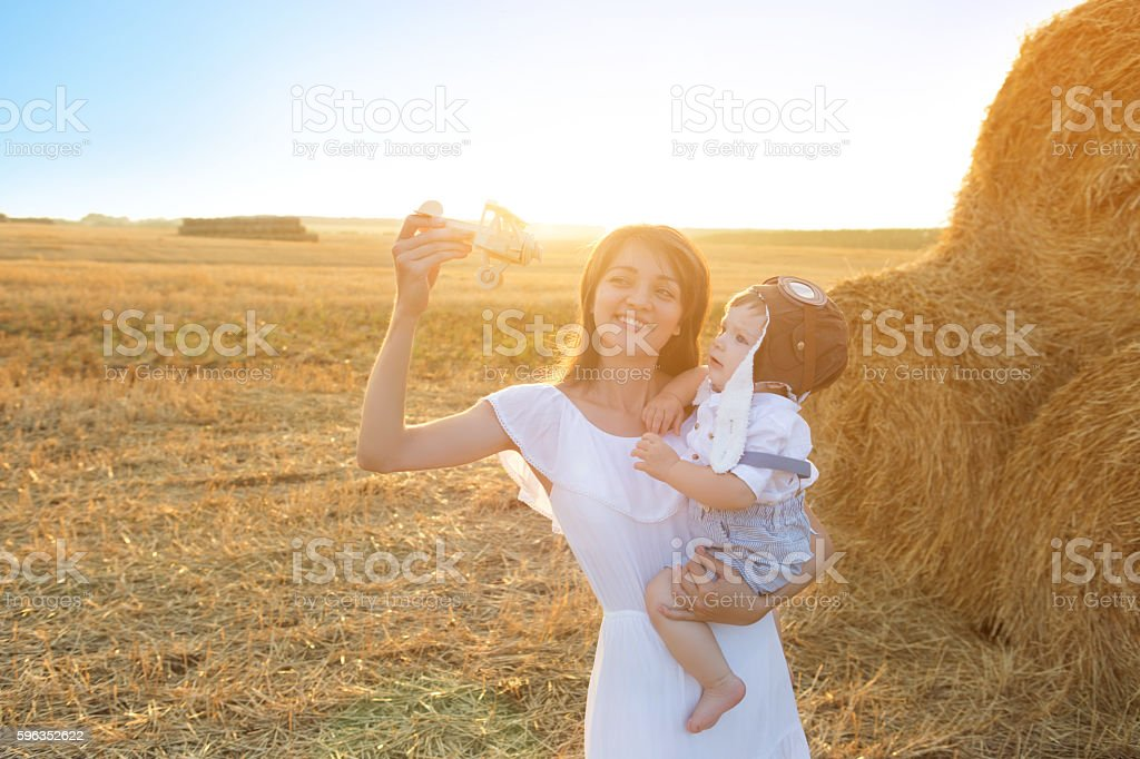 Little boy and mother to fly like a plane. royalty-free stock photo