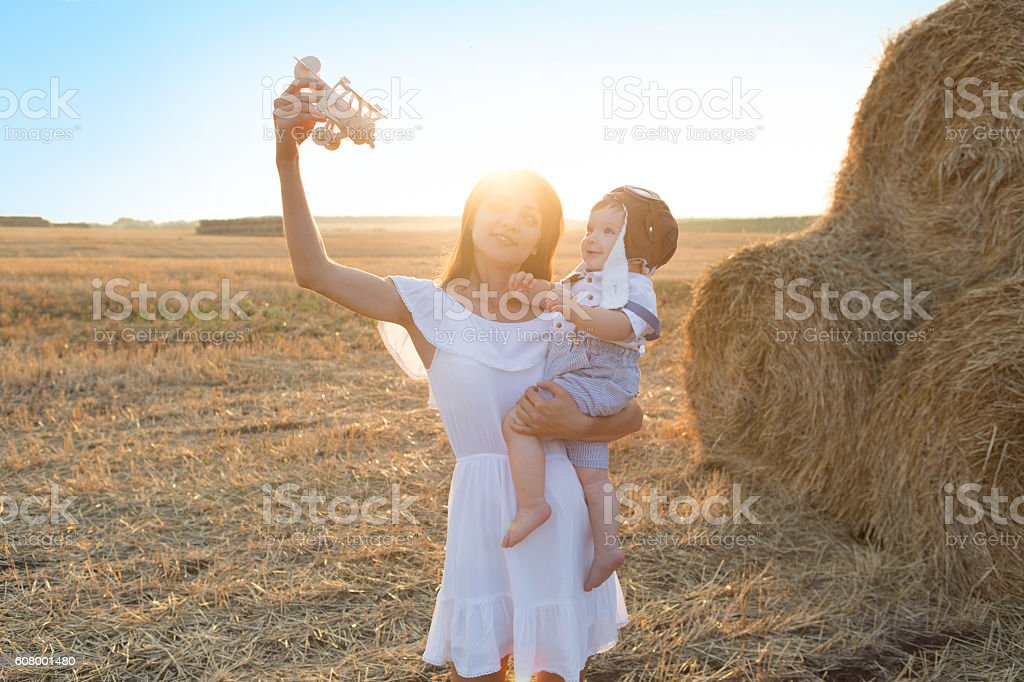 Little boy and mother to fly like a plane. stock photo