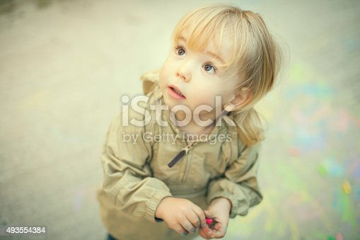 istock Little boy and sidewalk chalks 493554384