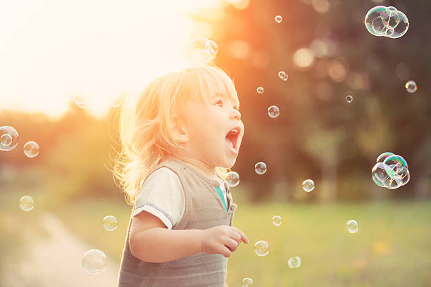 little boy and soap bubbles - cute stock pictures, royalty-free photos & images