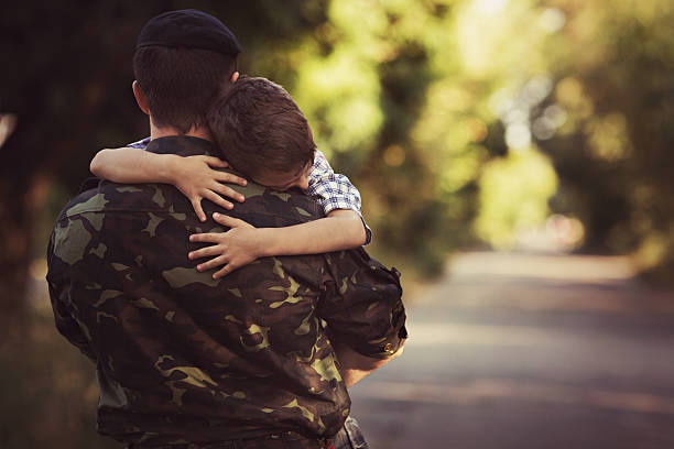 little boy and soldier in a military uniform - armed forces stock photos and pictures