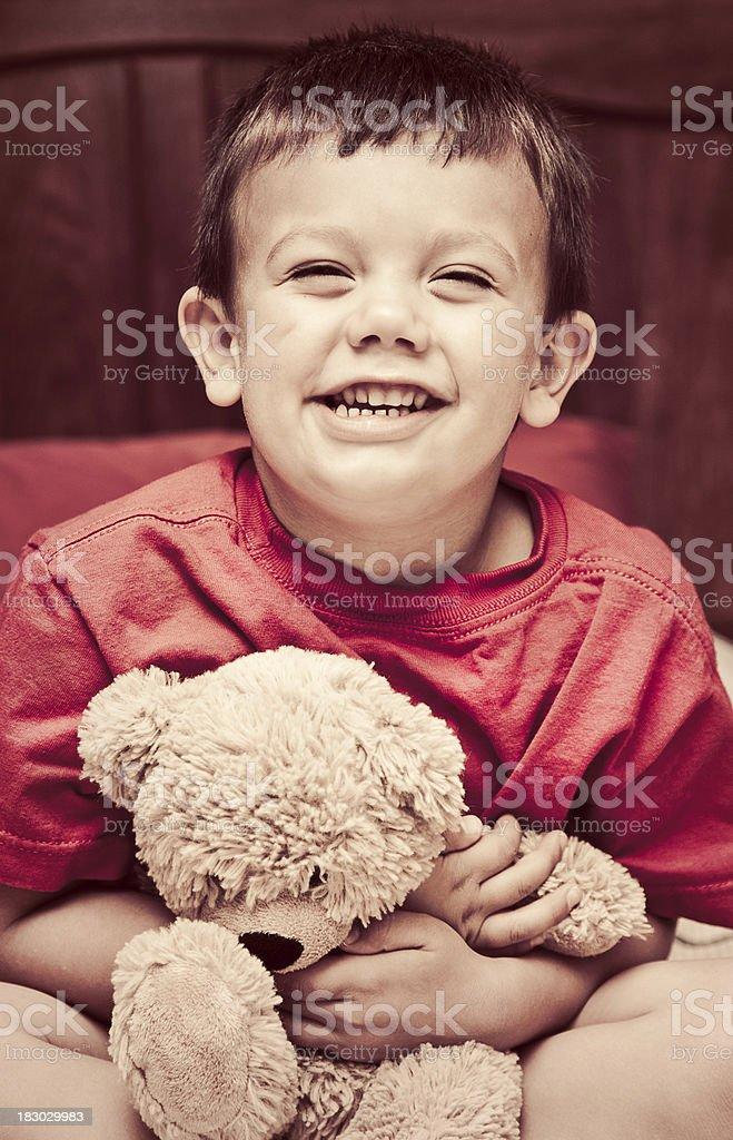 Little Boy and Teddy Bear stock photo