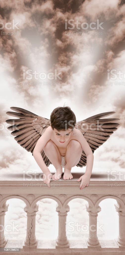 Little Boy Angel sitting on balustrade royalty-free stock photo