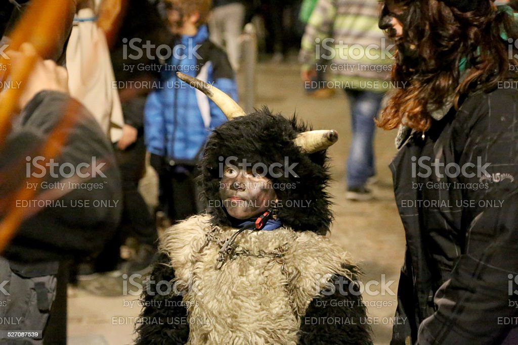 Little boy as Krampus stock photo