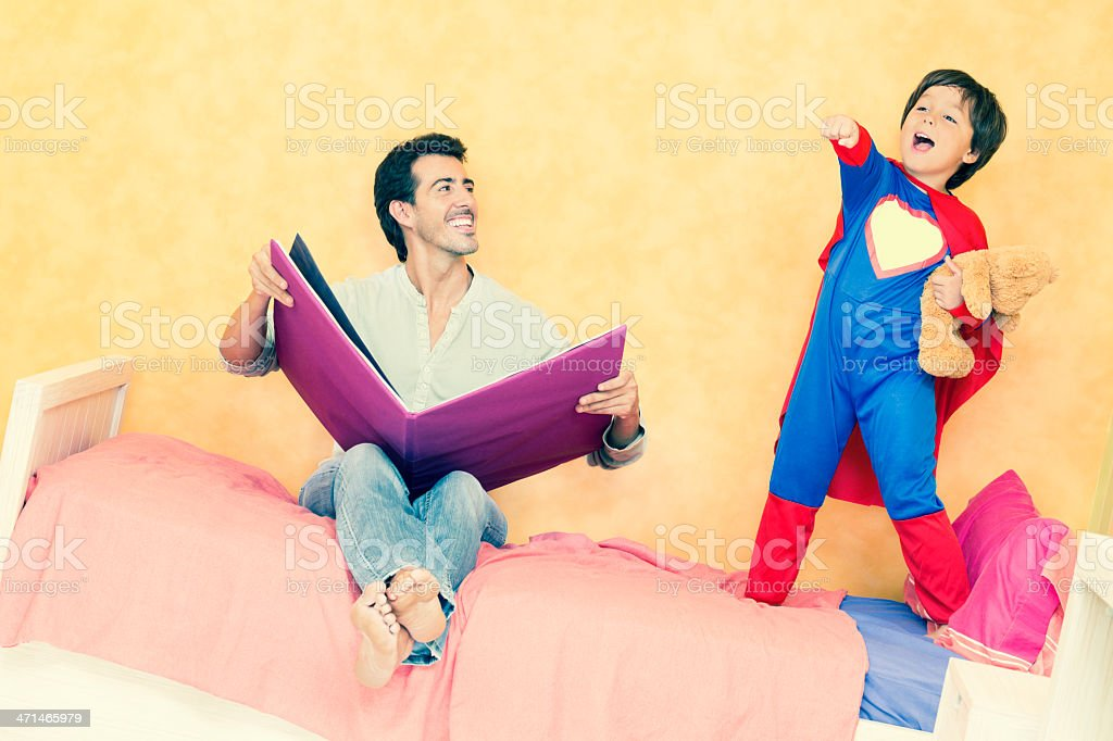 little boy as superman with dad in his nursery royalty-free stock photo