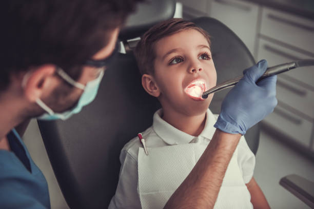 little boy at the dentist - dentist stock photos and pictures