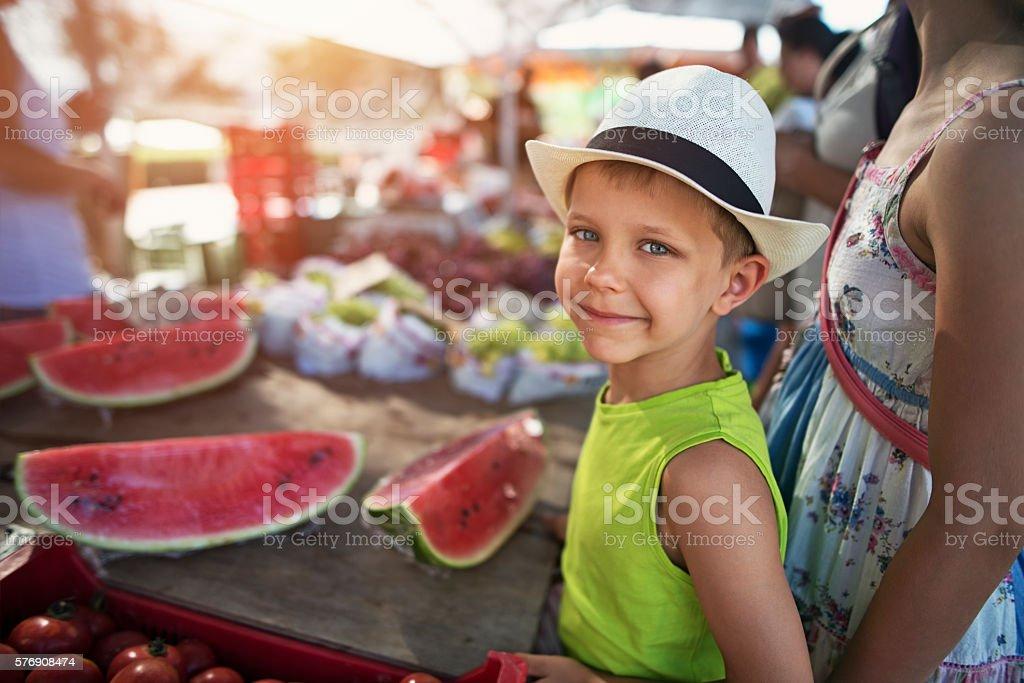 Little boy at the majorcan farmer's market stock photo