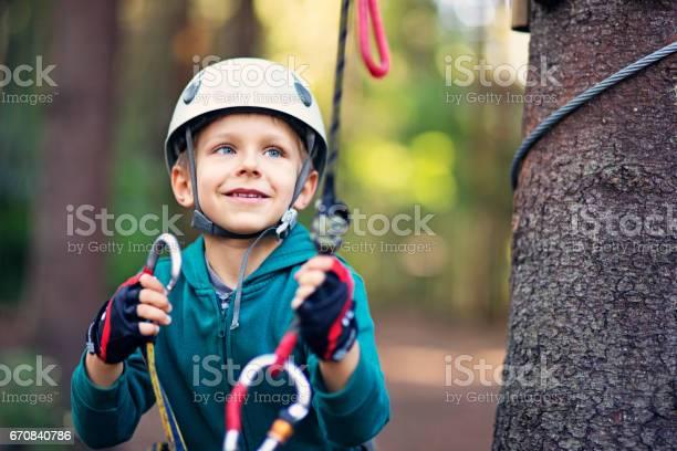 Little boy attaching carabiner to zip line picture id670840786?b=1&k=6&m=670840786&s=612x612&h=tzx nngbpefzbkkvwcbg y ay8z57cxx72d5zkxt9vu=