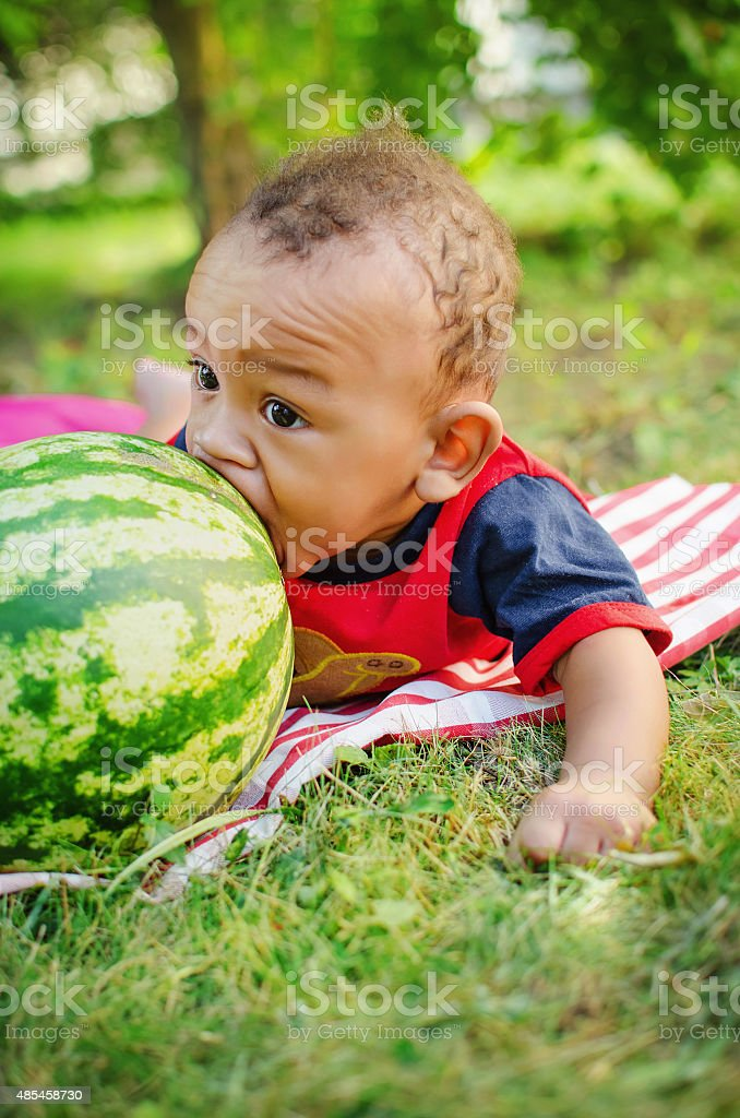 little boy  biting watermelon stock photo