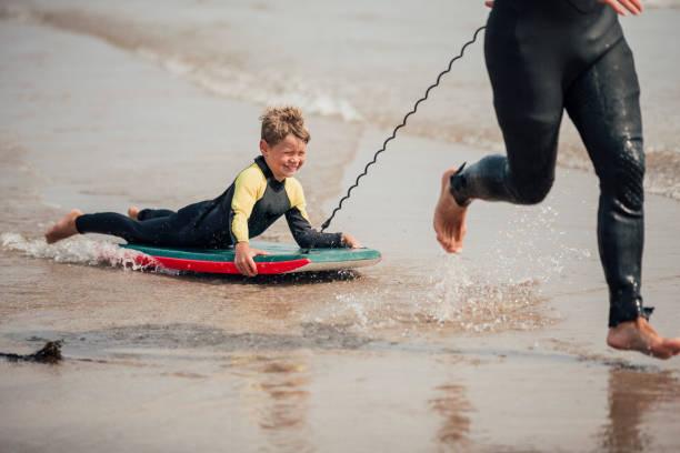 Little Boy bodyboard - foto de acervo