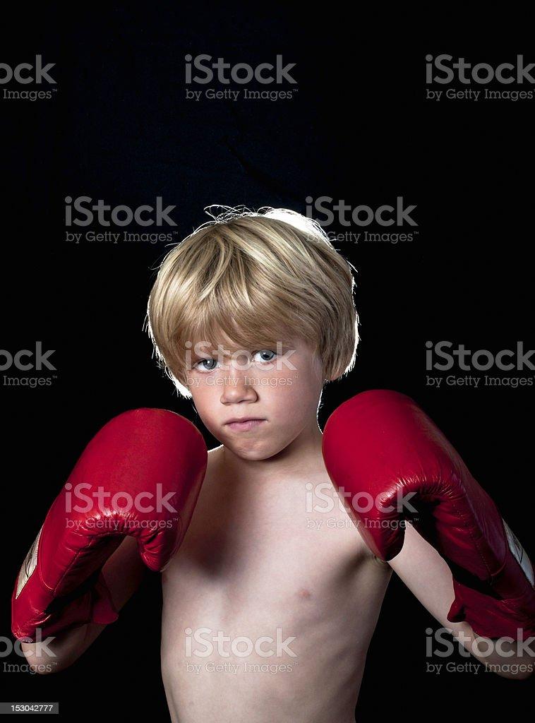 Little boy boxing stock photo