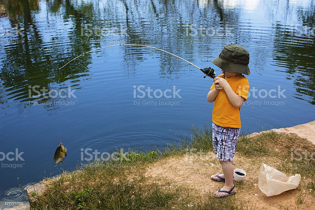 Little Boy Catching a Fish stock photo