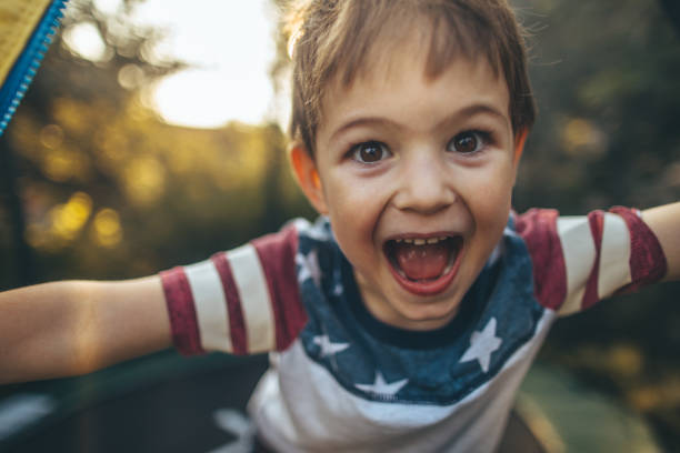little boy celebrating fourth of july - independence day stock photos and pictures