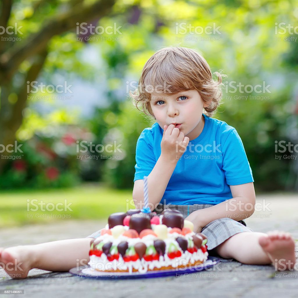 Little Boy Celebrating His Birthday With Big Cake Stock Photo More