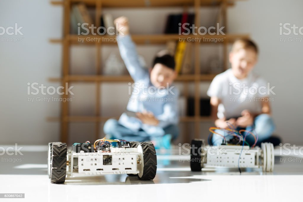 Little boy celebrating victory in a racing game stock photo