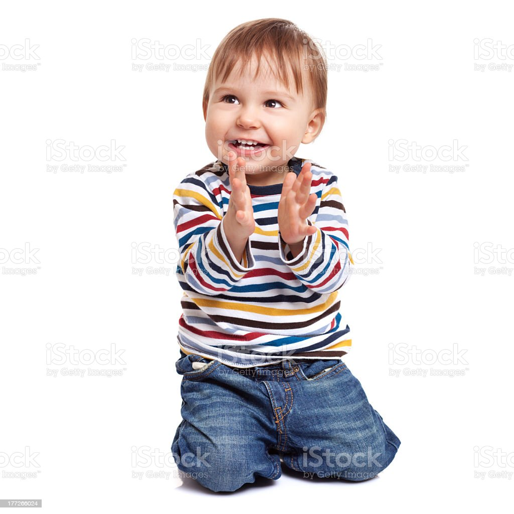 Little boy clapping his hands and smiling stock photo