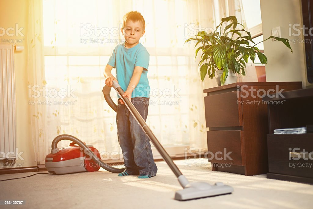 Little boy cleaning stock photo