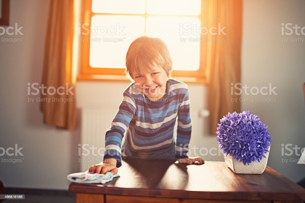Little boy cleaning room stock photo