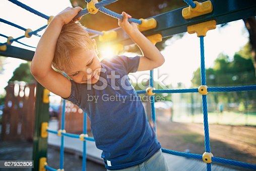 istock Little boy climbing on the playground 627932806