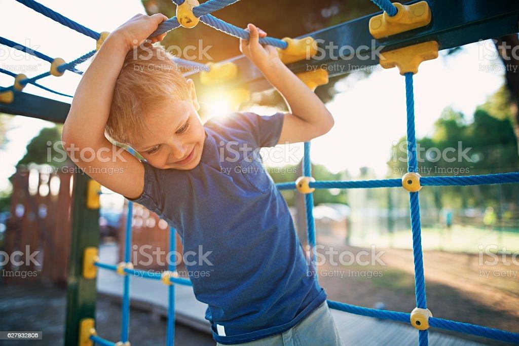 Little boy climbing on the playground – Foto