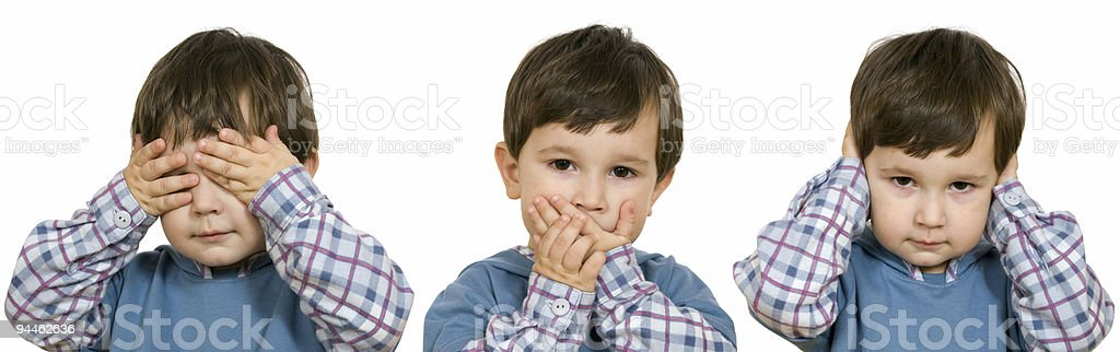 Little boy closes hands a mouth, eyes, ears royalty-free stock photo