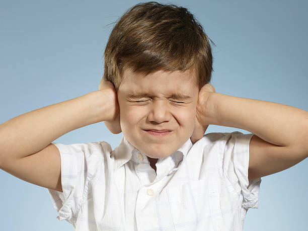 little Boy closing his ears Cute boy making a gesture hands covering ears stock pictures, royalty-free photos & images