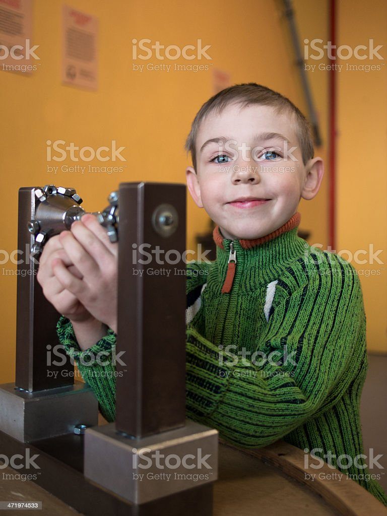 Little boy collects constructor stock photo