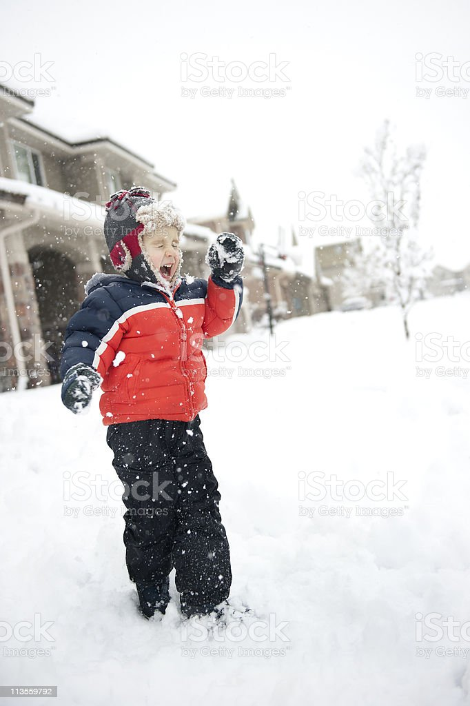 Little boy crying in a snowball fight stock photo