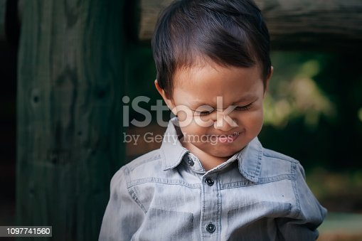 istock A little boy crying or throwing a temper tantrum with a frowned face, associated with emotional distress. 1097741560
