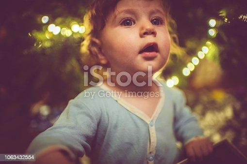 Cute child near Christmas tree