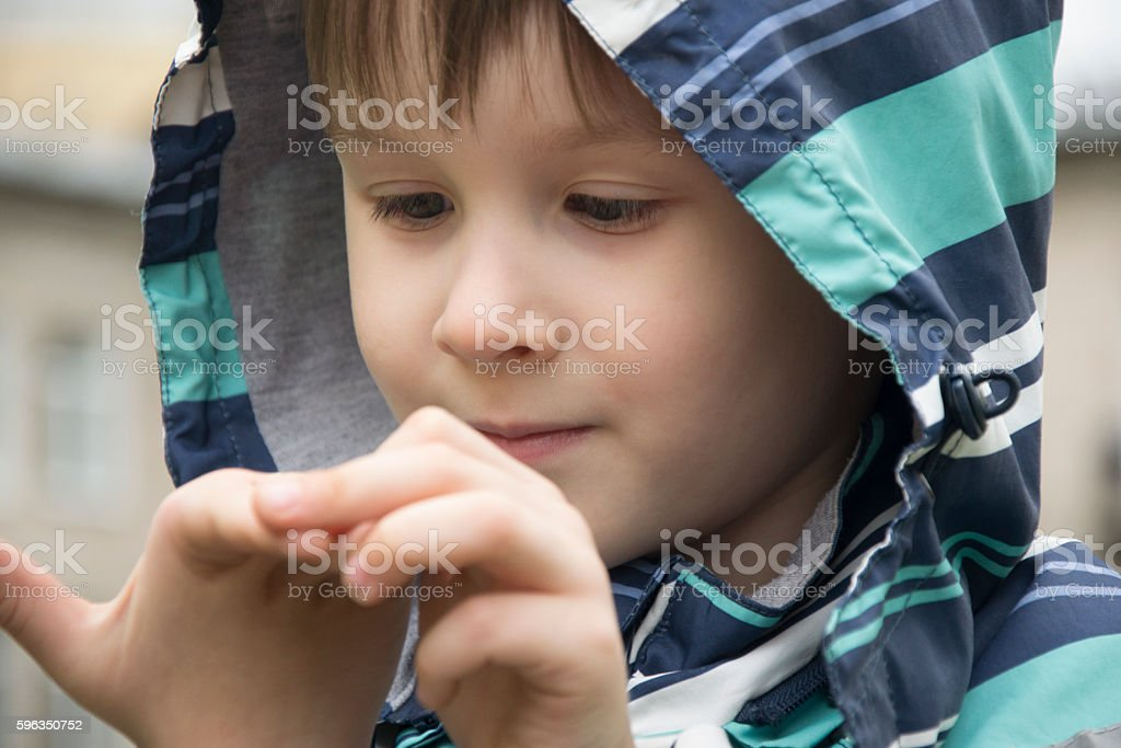 Little boy curious of his hand royalty-free stock photo