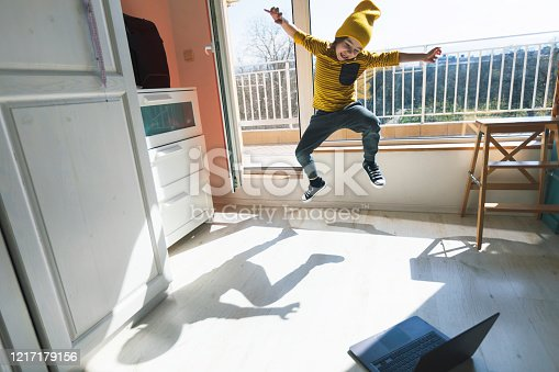 Little boy dancing break at home. Home Pleasures. E-learning. Illness prevention. Quarantine.